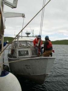 TAS Jacquelyn Hams helps prepare lines on a boat