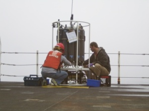 Charlotte Hill and Erich Rienecker collect water samples from a CTD cast.