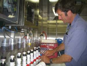Erich Rienecker sets up the filter system to process phytoplankton from the CTD casts.
