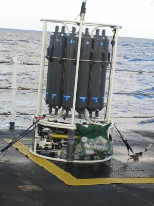 The CTD on the fantail of the MCARTHUR II with Styrofoam cups in the green mesh bag for the second deep cast of -4500 meters.