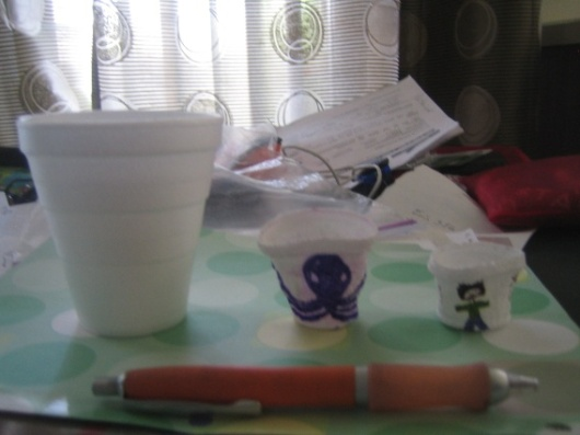 "This is a ""regular"" Styrofoam 10 oz cup and the two cups that returned from 4500 meters. The far right cup has a Flat Stanley drawn on it."