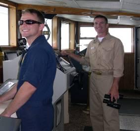 Chris Daniels, Operations Officer, and Kurt Zegowitz, Executive Officer, on the bridge sailing the NOAA ALBATROSS IV