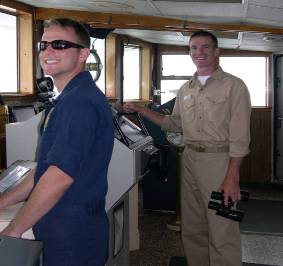Chris Daniels, Operations Officer, and Kurt Zegowitz, Executive Officer, on the bridge sailing the NOAA ALBATROSS IV