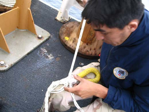 Here a scientist from the Chilean Navy is seen splicing in an eye into the line after it was cut to length.  This process ensures that the buoy stays in the right location and does not wander too far.