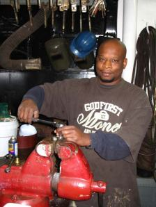 "Reggie Glover – Engine Utility Man (""Oilier"") helping keep the ship running smooth. Thanks Reggie!"