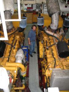 Any one like big diesel engines?  Jim Reed inspects the heart of the ship. The RON BROWN has six of these huge diesel engines connected to very large electric generators that in turn feed enough electricity to power the two 3000 horsepower engines that turn the propellers.
