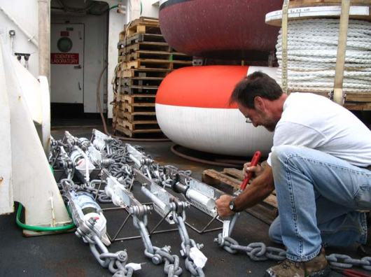 """Jeff Lord making final preparations for the dozens of instruments to be deployed beneath the buoy.  What an amazing man.  """"What would we do without you?"""""""