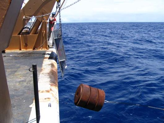 Everything is just moments before release.  This anchor weighs 9,000lbs and will take over 45 minutes to fall to the bottom of the ocean.  All the instruments are attached, glass balls secured, and the acoustic release in place.  Drum roll please………………….