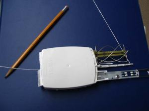 This is a radiosonde, which measures relative humidity, temperature, barometric pressure, and winds as it passes through the atmosphere and radios its data back to the scientist.