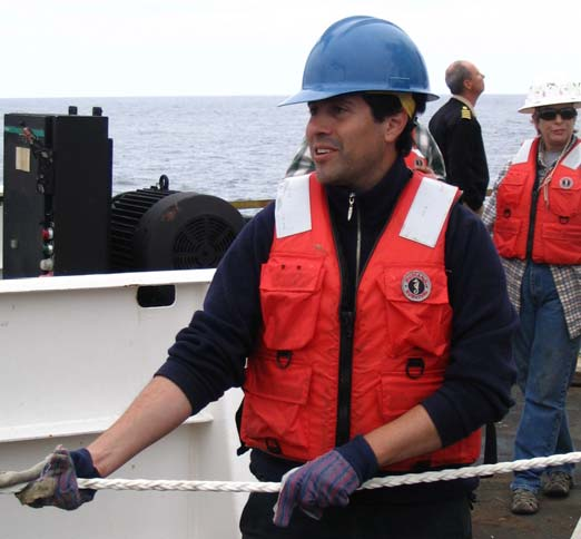 Jorge Gaete, a civilian contractor for the Chilean Navy for the past 2 years, helps with the deployment of the tsunami buoy.
