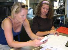 Melissa Ellwanger (left) and Stacey Etheridge (right)check the results from the test strips for PSPs.
