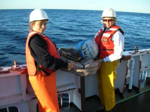 Tamara Browning, a teacher from Tenafly Middle School, Tenafly, NJ, and Karen Meyers deploy a drift buoy in the Gulf of Maine.