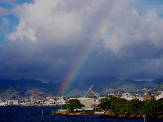 A rainbow is seen over Pearl Harbor as the OSCAR ELTON SETTE sets sail for its 30 day mission to survey the lobster population of the NWHI.