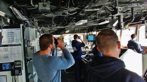 NOAA Commissioned Officers and Third Mate Carl VerPlanck of the Deck Department navigate NOAA Ship Rainier