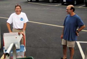 Amy Pearson helping Chief Scientist Jerry Prezioso load equipment onto  DELAWARE II