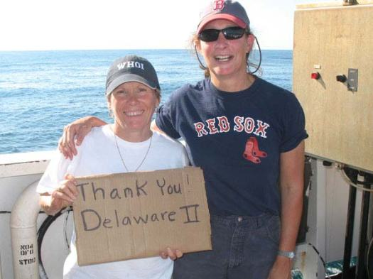 Teachers Kim Pratt and Amy Pearson say thanks to the crew of the DELAWARE II.