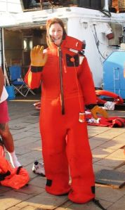 Amy Pearson dons her survival suit during a safety drill