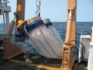 A crewmember bringing in the CTD and Bongo Nets after sampling