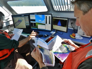 Reviewing the data and documents during the mission