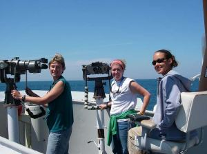 From left to right; Melissa Warden, Kate Swails, and Methea Sapp staff their observatory stations on the flying bridge of the DELAWARE II
