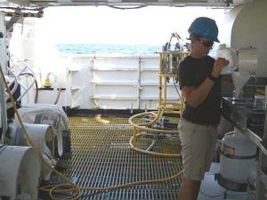 Teacher at Sea, Allison Schaffer, rinsing one of the bongo samples into a glass container to be preserved