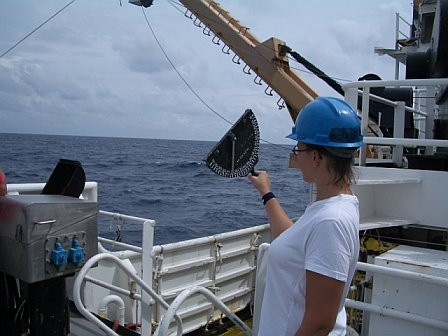 Teacher at Sea, Allison Schaffer, taking wire angle measurements for the bongo nets using the inclinometer.
