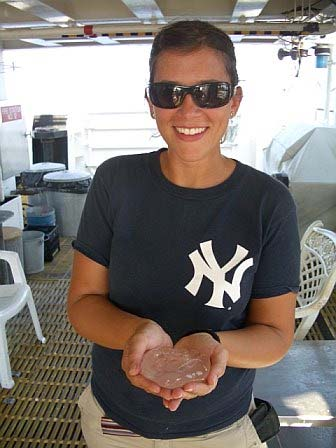 Teacher at Sea, Allison Schaffer holding a cannon ball jelly caught in the Neuston net