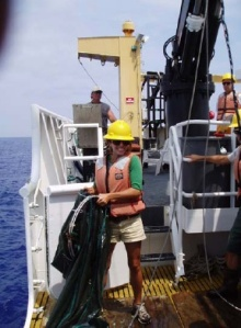 NOAA Teacher at Sea, Jenny Holen, getting ready to toss the cod end of the Isaacs-Kidd net overboard in hopes of catching billfish eggs and larvae off the Kona coast of the Island of Hawaii