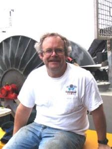 Dr. Robert Weller sitting on the aft deck