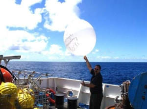 NOAA Teacher at Sea, Mr. Hoyt, releasing a radiosonde off the aft deck