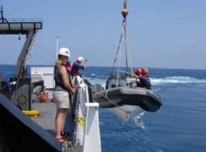 Crew of the NOAA ship NANCY FOSTER deploys a small boat at a pre-marked dive site.