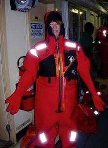 NOAA Teacher at Sea, Miriam Hlawatsch, dons a survival suit