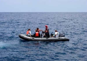 Divers take a small boat to the dive site.