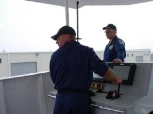 CDR James Verlaque supervises as ENS Marc Weekley docks NOAA ship NANCY FOSTER in the Morehead City port.