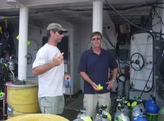 NOAA divers, Thor Dunmire and Roger Mays analyze air supply tanks during our stay in the Morehead City port.