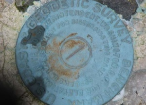 One of five Geodetic Survey Benchmarks at Dorothy Cove
