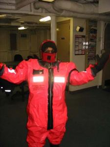 Linda Armwood dons her survival suit aboard the Fairweather