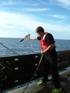 Survey team member Friedrich Knuth send an XBT expendable probe over the side.