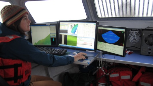 Rosalind working the surveying computers in the launch