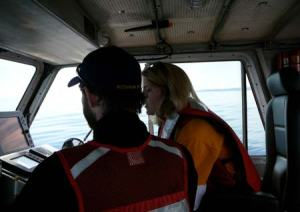 Grant shows me the ropes of driving the boat