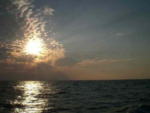Early morning sunrise 50 miles off the coast of North Florida viewed from the deck