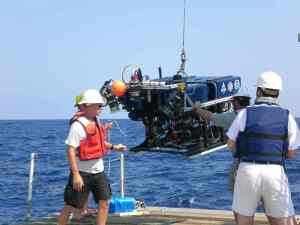 Recording digital images relayed from the ROV at 207 feet below the surface of the ocean.
