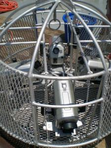 The camera array secures four digital video cameras in waterproof containers to a frame that is tethered and lowered to the ocean floor.