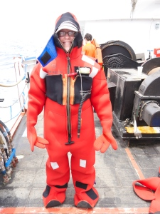 The Abandon Ship drill requires everyone on board to get into a survival suit. It's not easy.