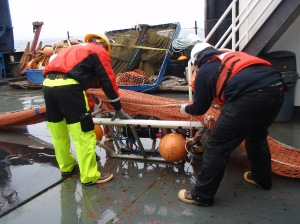 The CamTrawl being attached to the net.