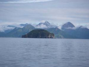 Olga Island rising abruptly from the sea.
