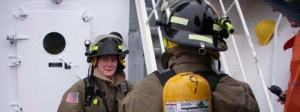 Ensign Megan McGovern and crew partner in full firefighting bunker gear for our first Fire/Emergency Drill.