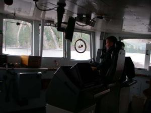 CDR Guy Noll on the bridge of NOAA ship RAINIER.