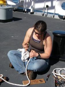 AS Leslie Abrahamson splicing lines aboard NOAA ship RAINIER.