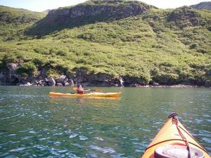 Intern Umeko Foster exploring the coastline of Cushing Bay on Mitrofania Island.